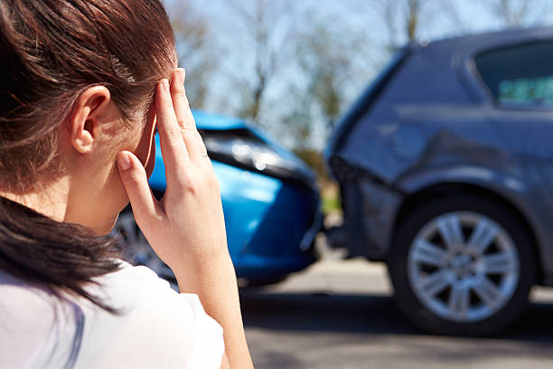 concerned driver with defocused traffic accident - impaired driving stock photos and pictures