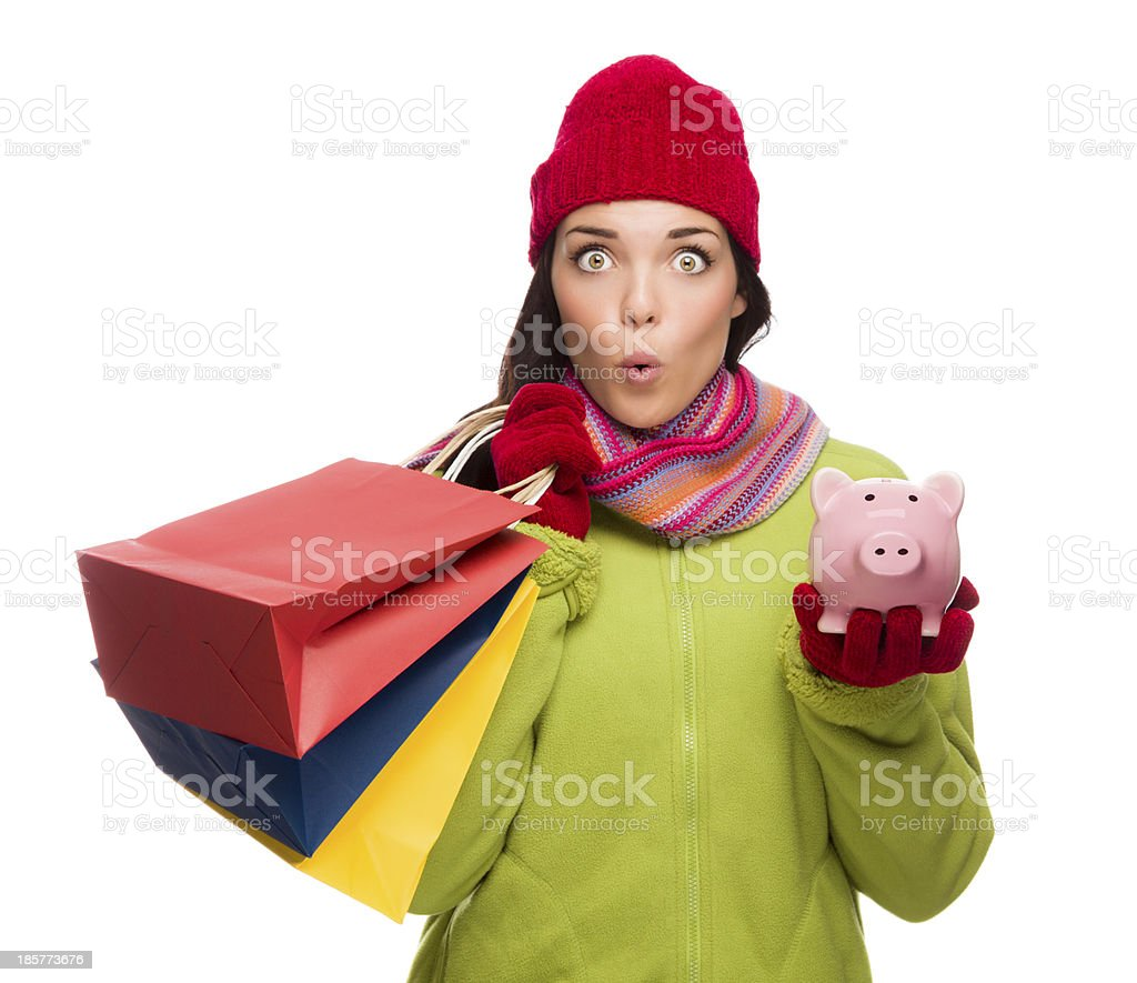 Concerned Expressive Mixed Race Woman Holding Shopping Bags and Piggbank stock photo