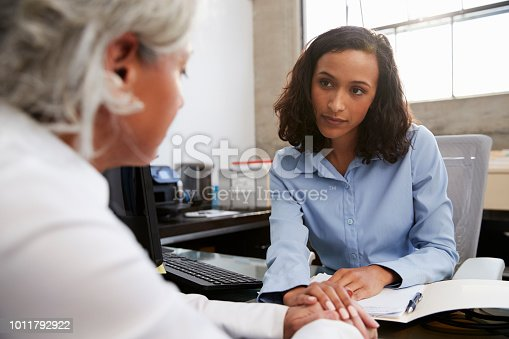 istock Concerned female analyst counselling senior patient 1011792922