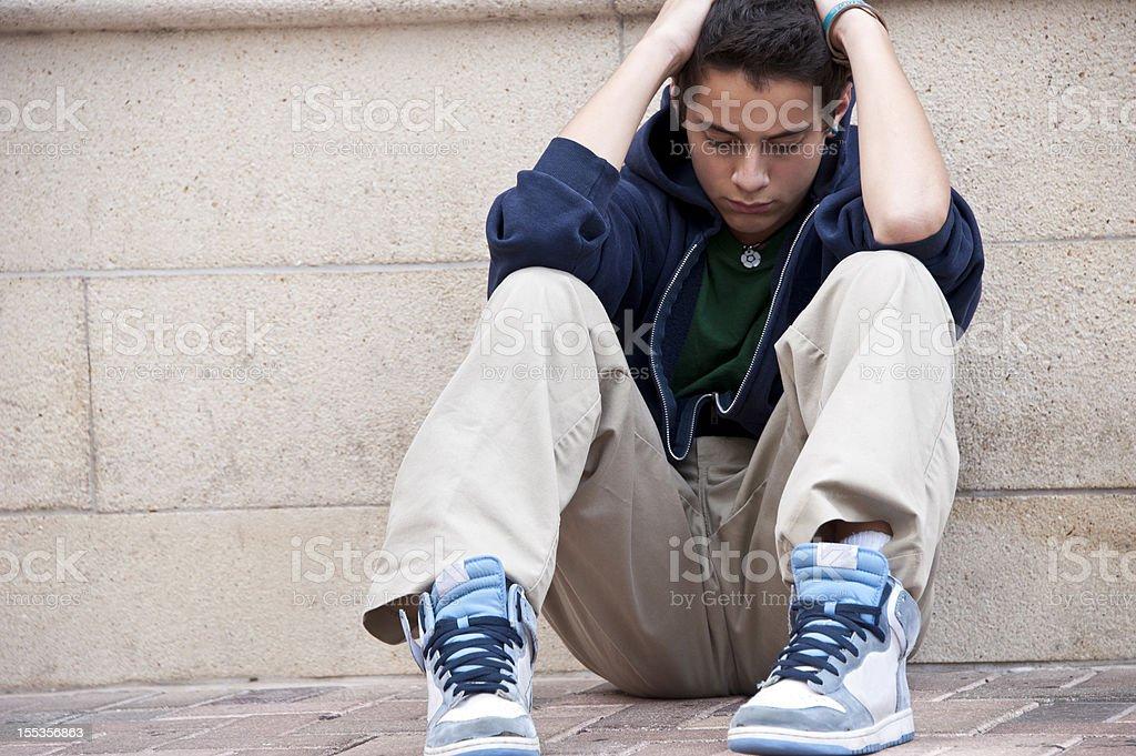 Concerned Hispanic Teenager stock photo