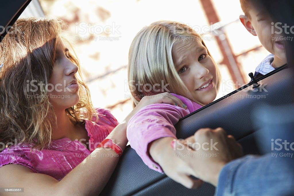 Concerned little girl on first day at school dropoff stock photo