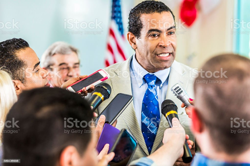 Concerned man adresses the media stock photo
