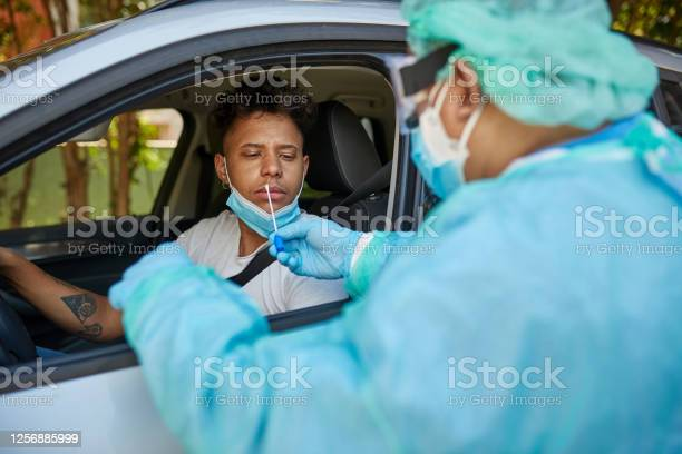 Concerned Man Getting Covid19 Nasal Swab Test At Drivethru Stock Photo - Download Image Now
