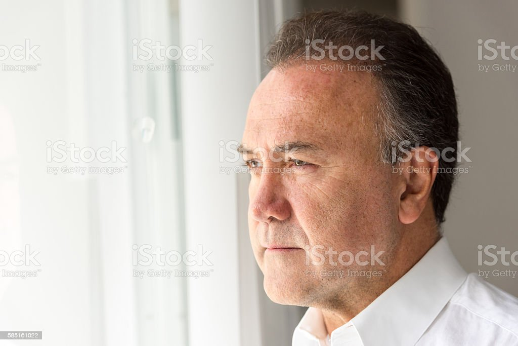 Concerned mature man stock photo