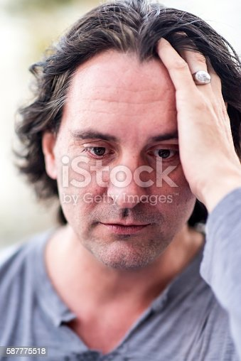 istock Concerned Mature man 587775518