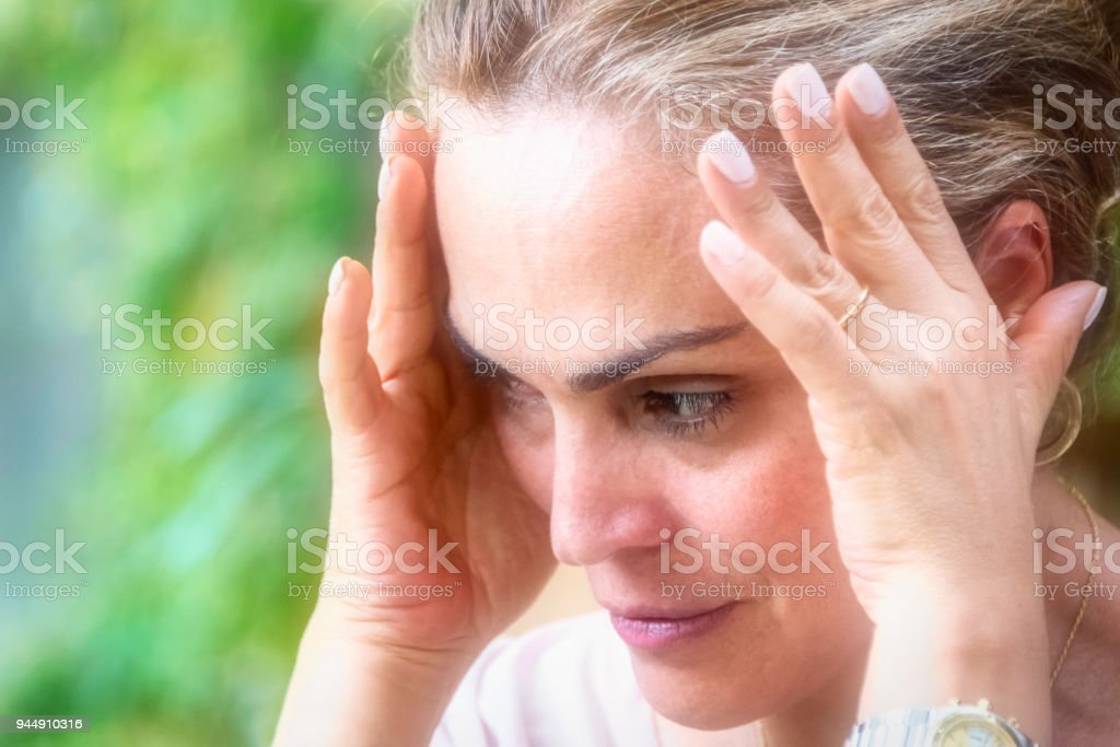 Concerned mature woman stock photo