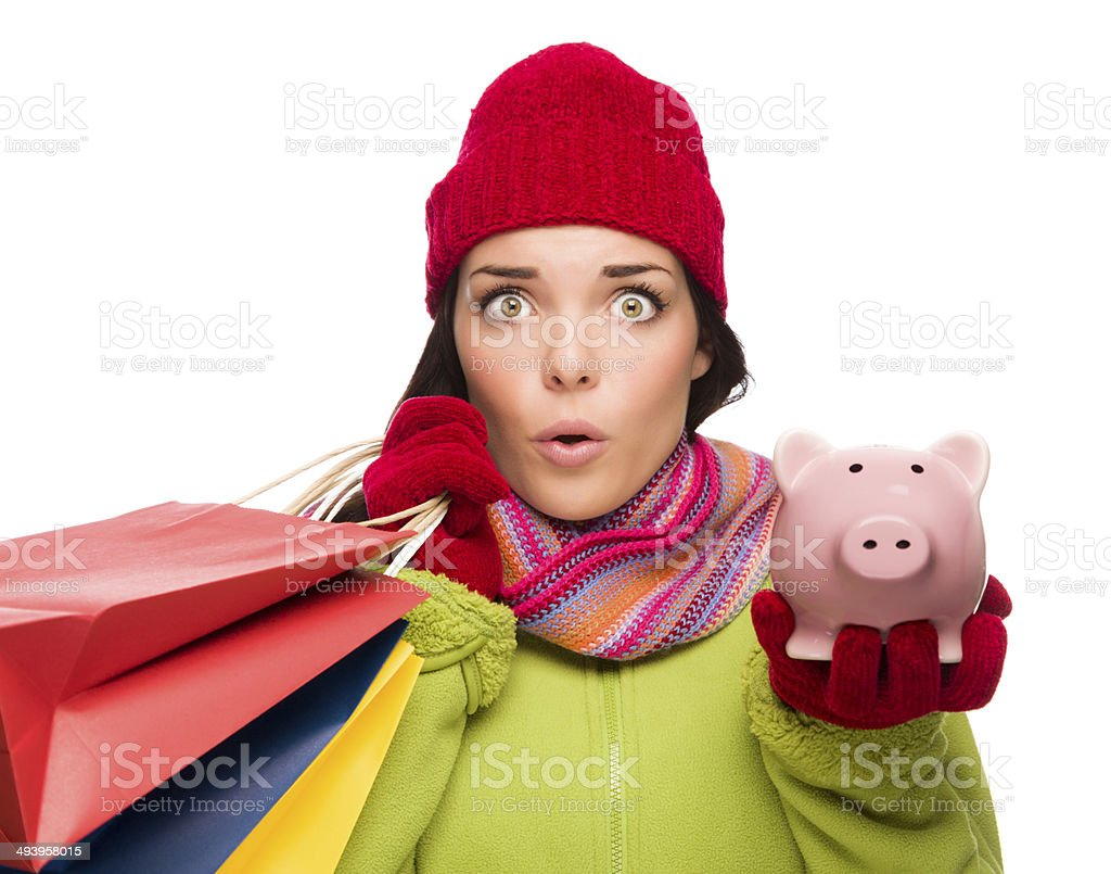 Concerned Mixed Race Woman Holding Shopping Bags and Piggybank stock photo