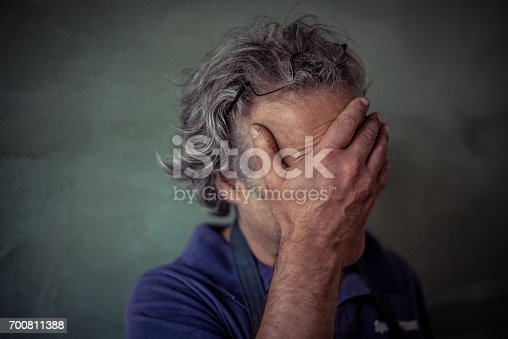 istock Concerned real mature man 700811388