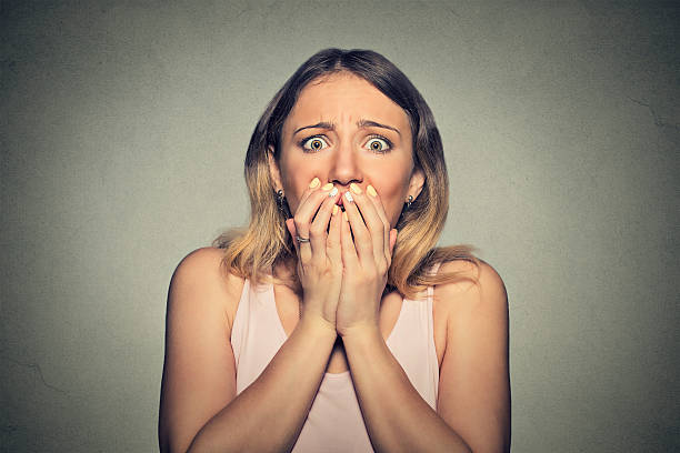 concerned scared woman - fear stock photos and pictures