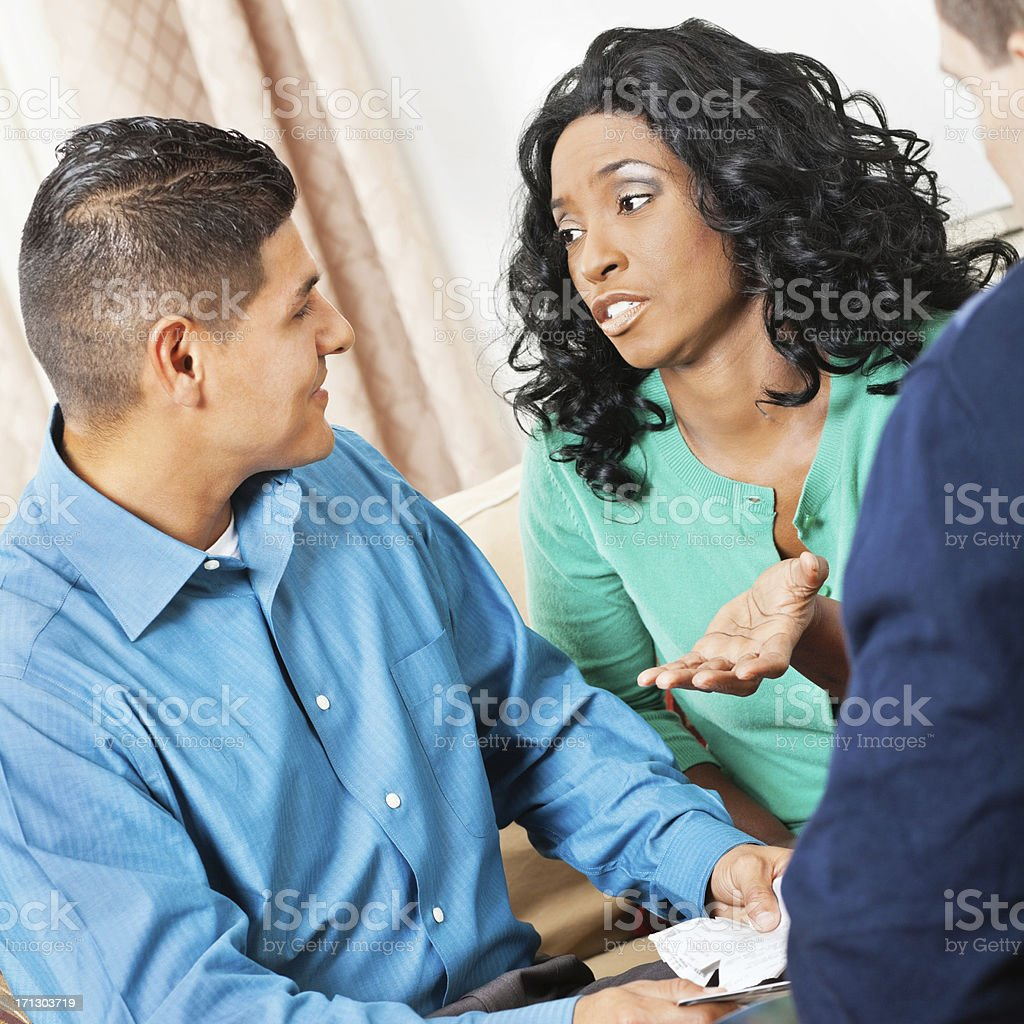 Concerned wife and husband during financial counseling session royalty-free stock photo