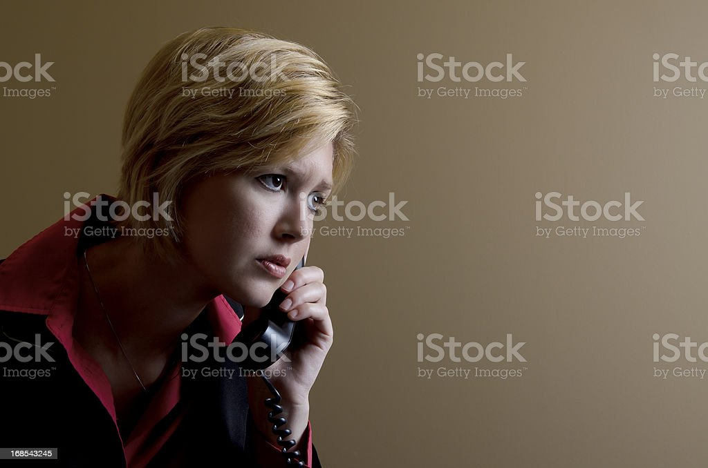 Concerned Young Woman on the Phone stock photo