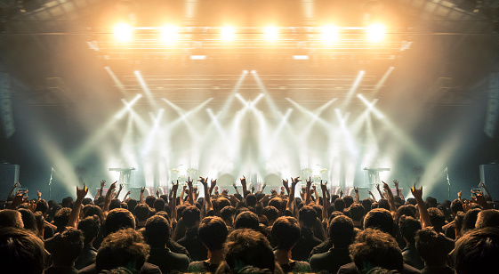 istock Concert arena with fans clapping 948930986