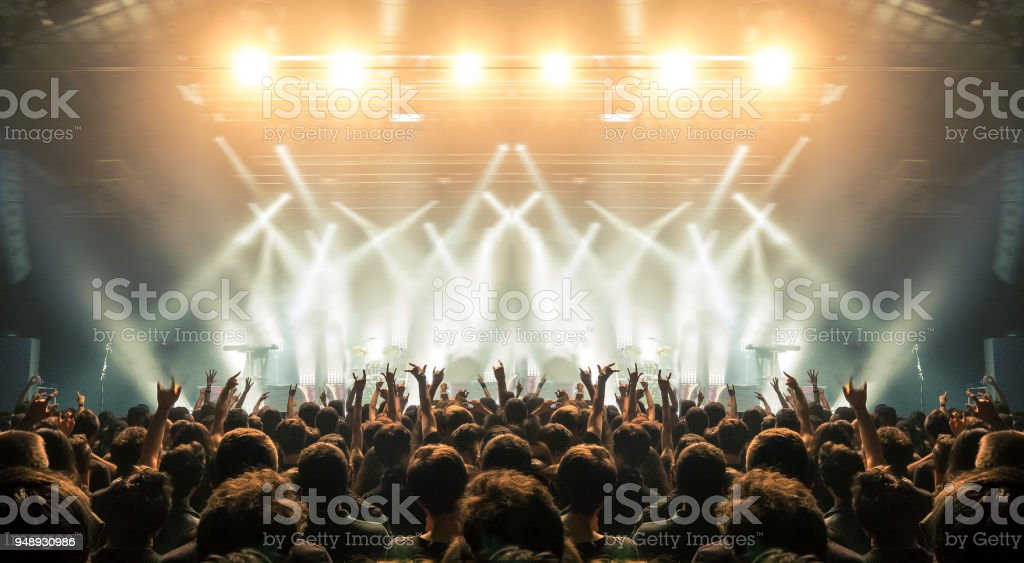 Concert arena with fans clapping stock photo