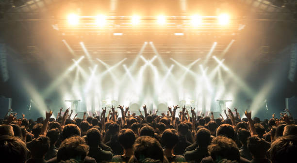 concert arena with fans clapping - rock music stock pictures, royalty-free photos & images