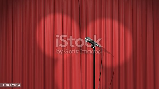 istock Concert Background, Red Curtain with Spotlights and a Microphone 1134159204