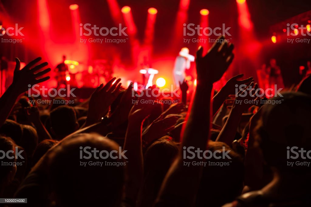 concert crowd during festival, hands of many people stock photo