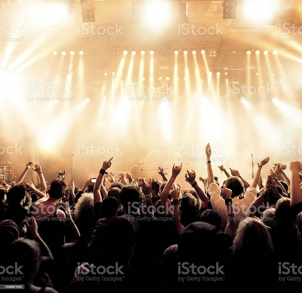 Concert crowd in front of stage lighting effects stock photo
