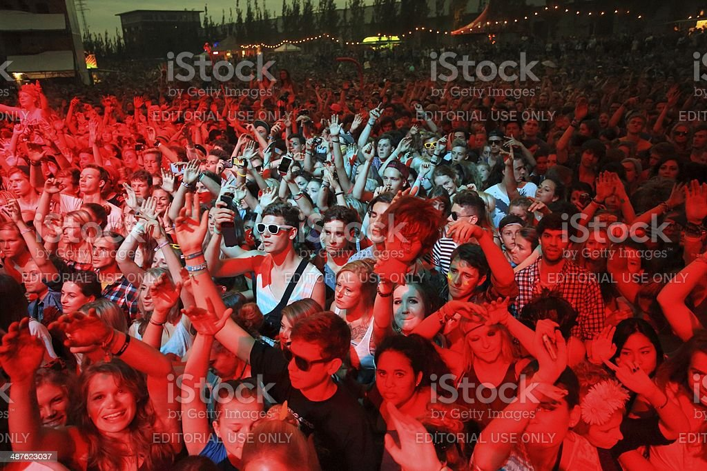 concert crowd in the spotlight at a music festival stock photo