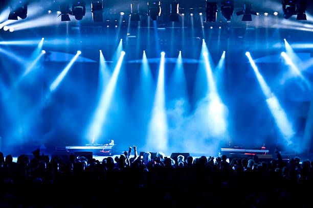 concert crowd - stage light stock pictures, royalty-free photos & images