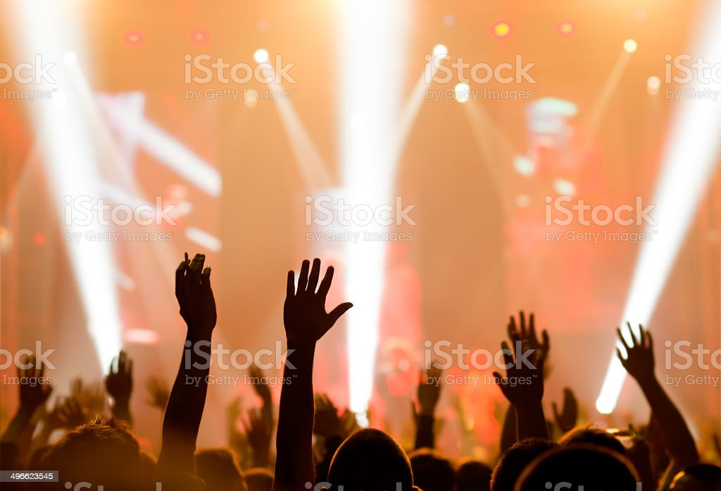 Crowd cheering and watching a band on stage, blurred motion, shallow...