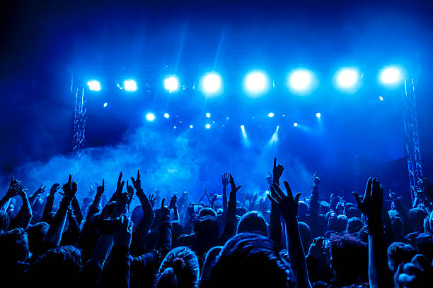 concert crowd - popular music concert stock photos and pictures