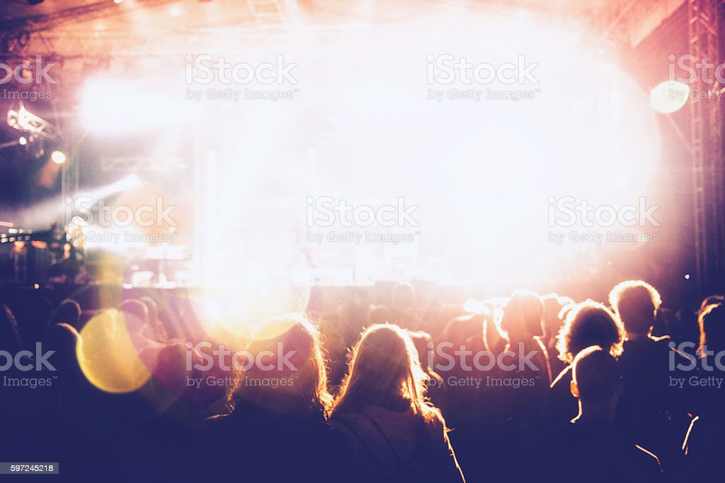 Concert crowd in front of bright stage-lights