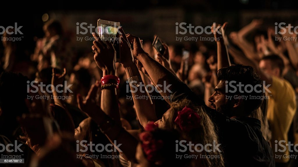 Concert crowd with raised hands stock photo