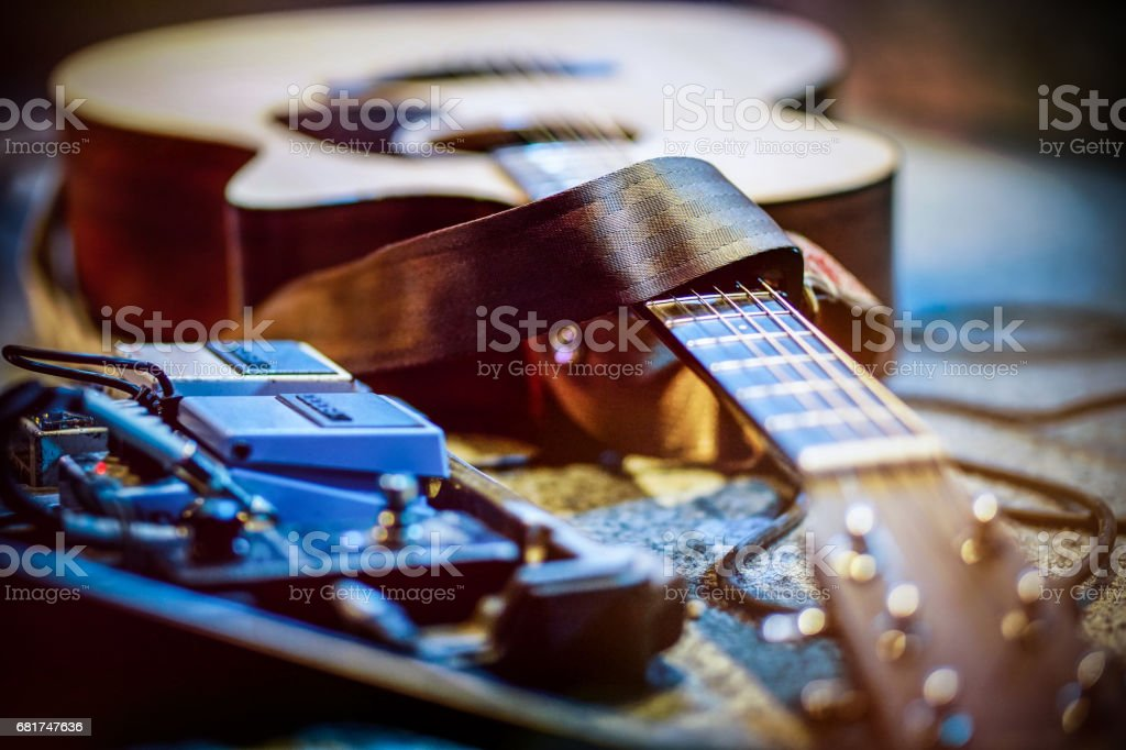 Concert Guitar with effects pedals stock photo