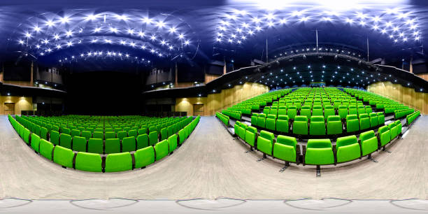 concert hall with green seats and scene stock photo