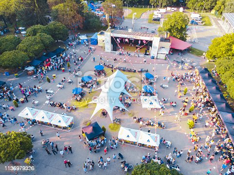 concert in city park. summer time. aerial view