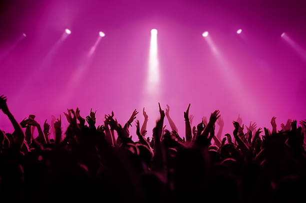 concert in pink - magenta stock photos and pictures
