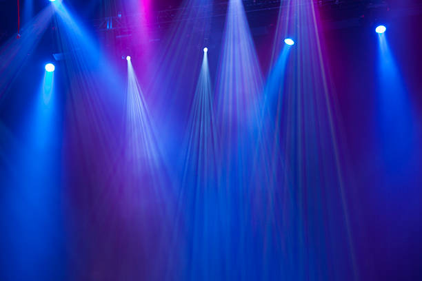 concert lighting Blue and purple concert stage lights. stage light stock pictures, royalty-free photos & images