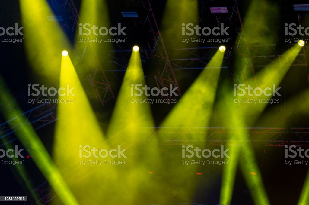 Concert lights, stage, show and excitement. Light spots in concert,...