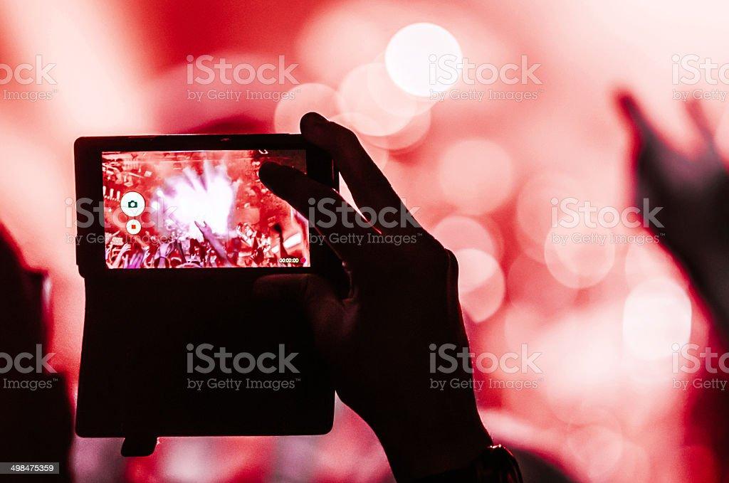 concert mobile bokeh red stock photo