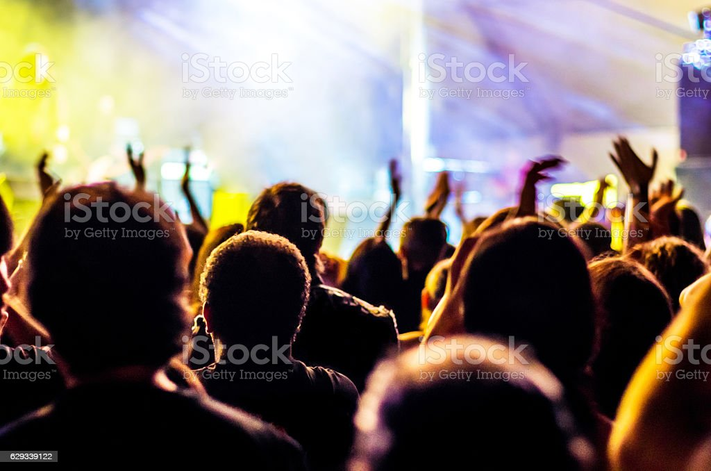concert ray light hands up people music bokeh band head stock photo