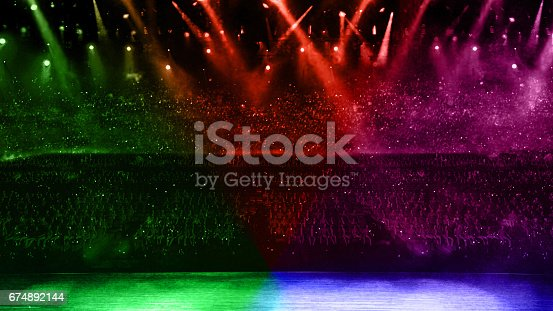 istock concert spotlight with color flare 674892144