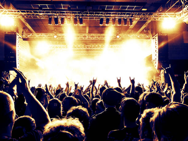 concert stage in a crowded venue - rock music stock pictures, royalty-free photos & images