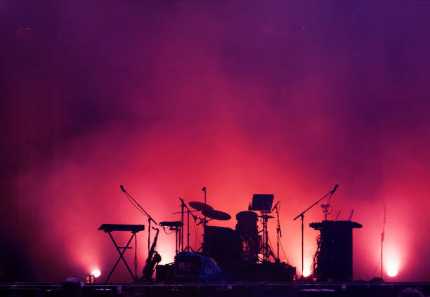 concert stage on rock festival, music instruments silhouettes stock photo