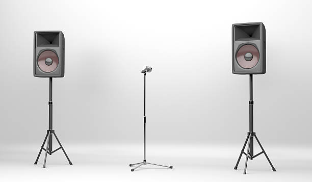 Concert stage with speakers and microphone stock photo