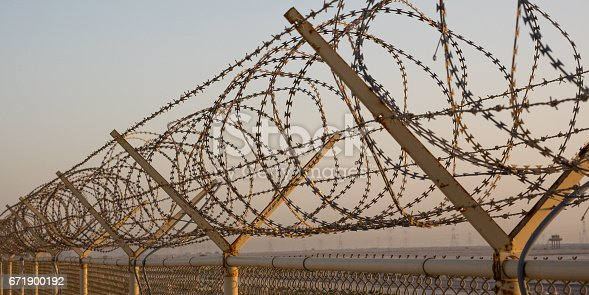 Concertina wire fence in Middle East Desert