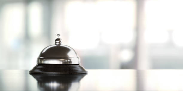 concierge bell over defocused background - bell stock pictures, royalty-free photos & images