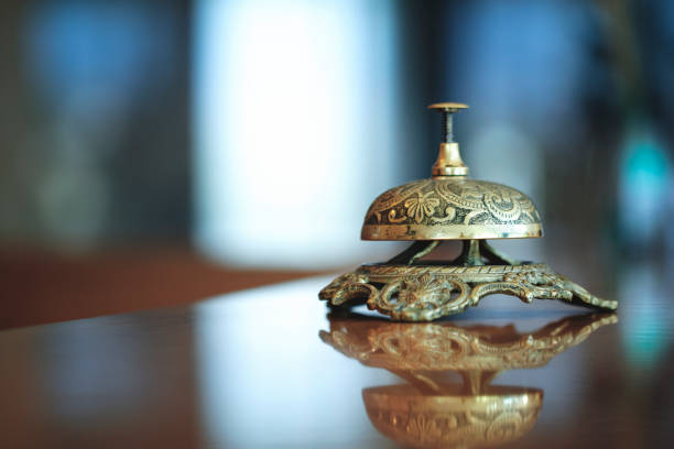 Concierge Bell Over Defocused Background Concierge Bell Over Defocused Background concierge stock pictures, royalty-free photos & images