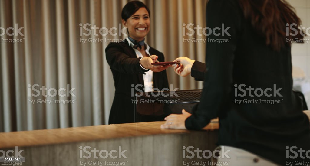 Concierge returning the documents to hotel guest stock photo