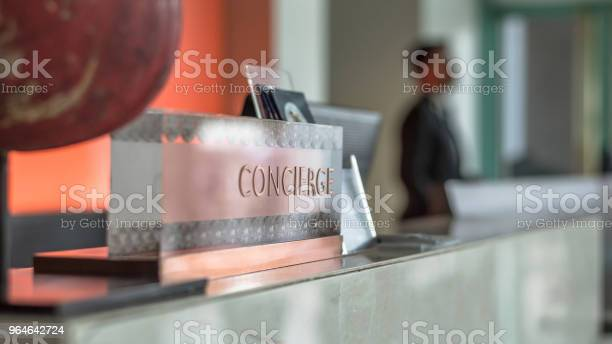Concierge service desk counter with hotel staff team working in front picture id964642724?b=1&k=6&m=964642724&s=612x612&h=nhzxznbticowlnvrht4q2e4awdil sp87qapqolv0hk=