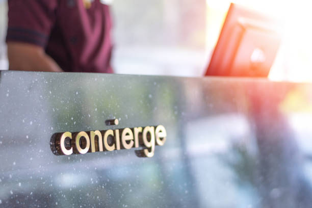 Concierge service desk counter with staff team working in front of hotel with tourist business customer. Concierge service desk counter with staff team working in front of hotel with tourist business customer. concierge stock pictures, royalty-free photos & images