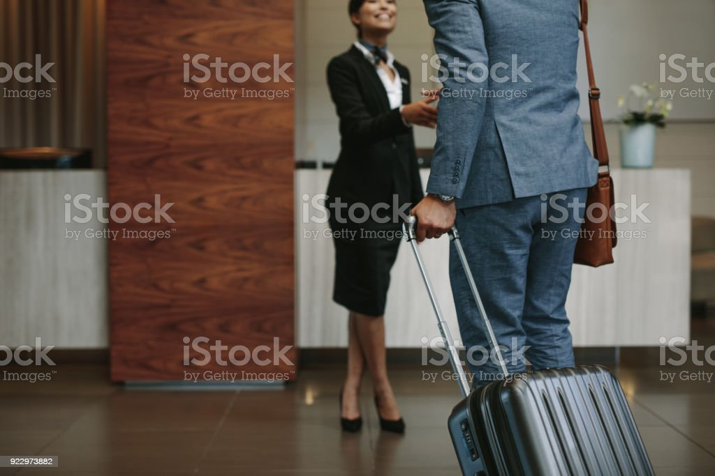 Concierge welcoming guest at hotel lobby stock photo