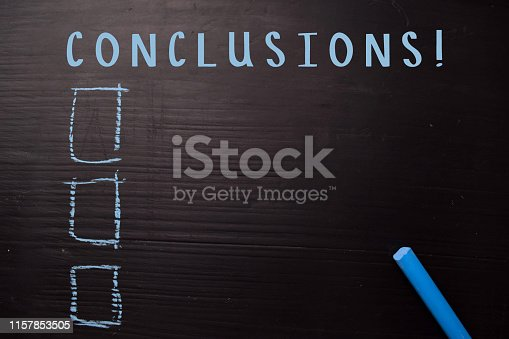 istock Conclusions! written with color chalk. Supported by an additional services. Blackboard concept 1157853505