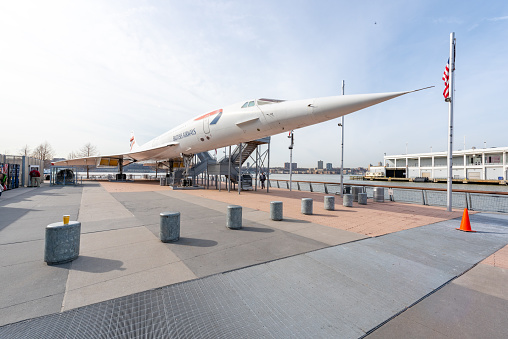 People visit Concorde at Intrepid Sea, Air and Space Museum in New York. The museum is located onboard USS Intrepid, retired aircraft carrier.
