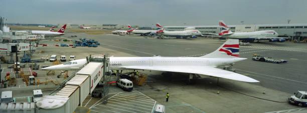 Concorde passenger jet airliner gate terminal Heathrow International Airport London England stock photo
