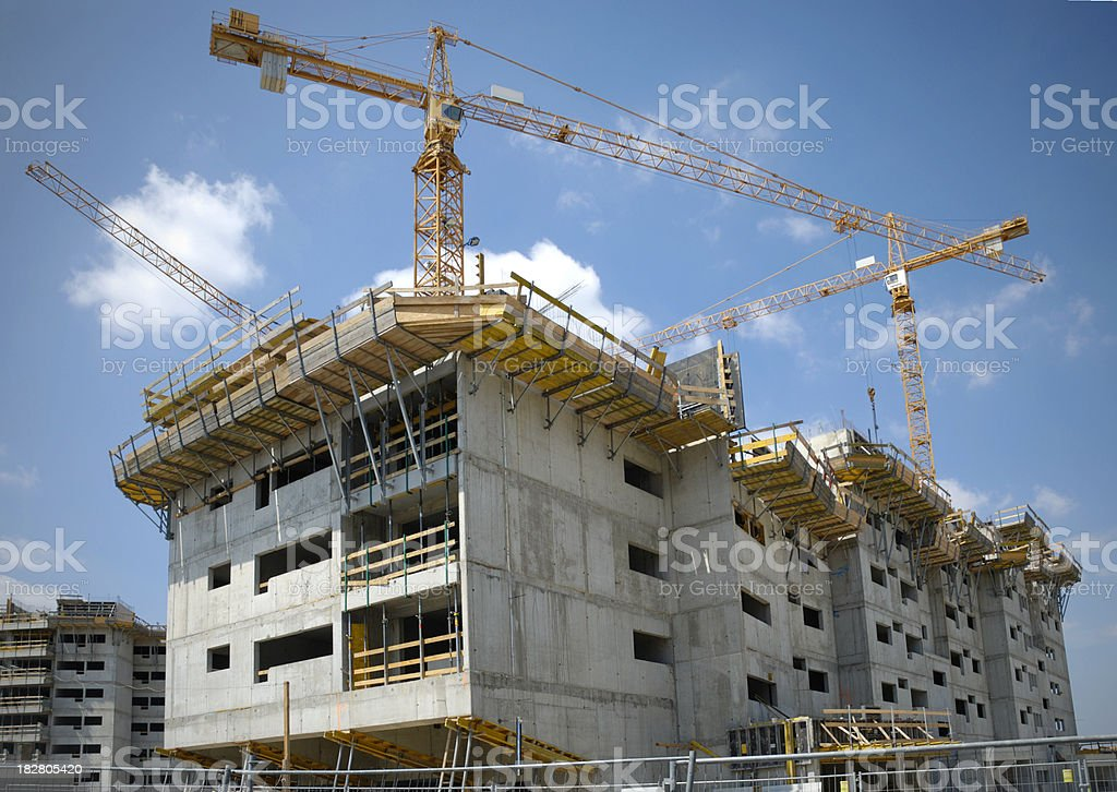 Concrete and Cranes royalty-free stock photo